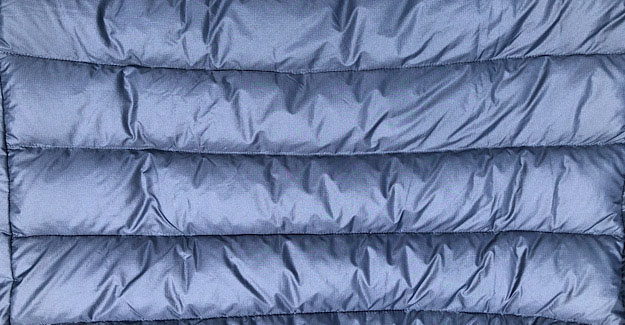 The  jacket has the larger baffles for more loft and warmth