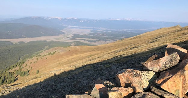 Looking out over wind break on Colorado trail taking a break from hiking