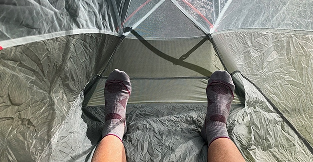 Feet Distance from bottom of tent laying down