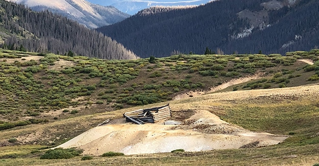 Piles of mining tailings around cabin