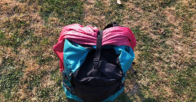 Backpack top strap